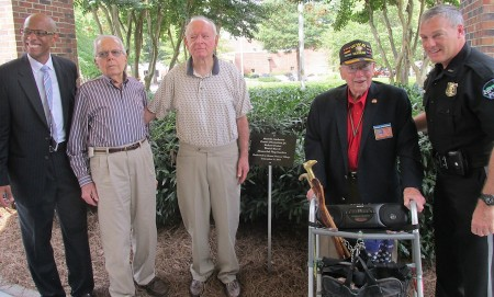 From left, Mount Vernon Village Administrator Michael Meyers, Robert Foster, Merritt Ambrose, Frank DiCristina Jr. and Sandy Springs Police Chief Ken DiSimon pose in the memorial garden.