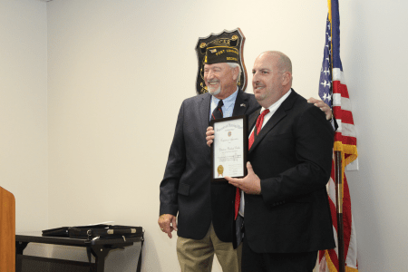 VFW Post Commander Loren Cook with Detective Mike Tuvlin during the awards dinner Sept. 8.