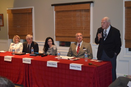 Left to right: District 1 County Commission candidates Wendy Butler, Larry Denese, Nancy Jacobs and Tom Owens listen as fellow candidate Holmes E. Pyles (standing) addresses the Dunwoody Homeowners Association a the Kingsley Swim and Racquet Club on Oct. 5.