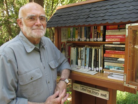 """David Carr built a """"Little Free Library"""" at his driveway's entrance on Lost Forest Drive."""
