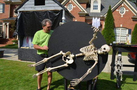 "Homeowner Jeff Marcus designs and builds the ""Scare Away Autism"" display for his yard every Halloween."