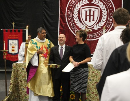 Left, the Rt. Rev. Rob Wright, bishop of the Episcopal Diocese of Atlanta, with Paul Barton, the new head of school at Holy Innocents', and his wife Leanne, at the Celebration of New Ministry service.
