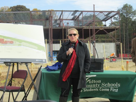 School board member Gail Dean addresses the crowd gathered for the groundbreaking of the future Heards Ferry Elementary School.