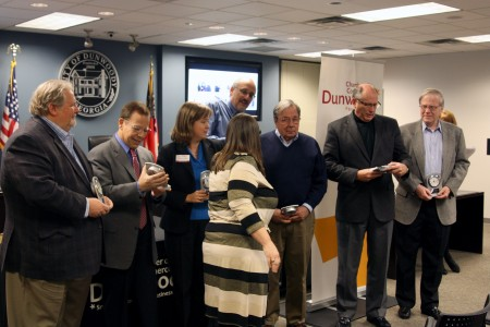 Dunwoody Chamber of Commerce presented its retiring Board of Directors members with desk clocks. The retiring directors (not all shown) are: Donna Mahaffey, Fred Cerrone, Jeff Priluck, Jennifer Howard, Bill Mulcahey, Bill Grant, Don Boyken and Larry Feldman.