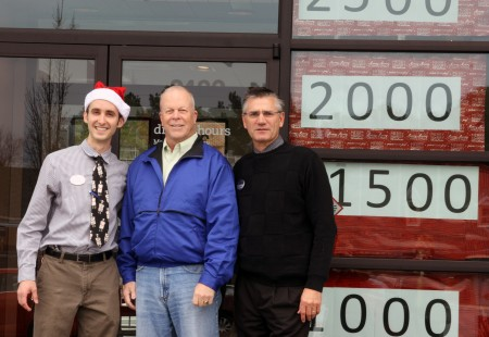 Marketing Manager Mark Bartolucci, Dunwoody Mayor Mike Davis and Chick-fil-A Store Owner Grant Wells celebrate on Dec.18 hitting the 6,000 mark toward a goal of 10,000 meals donated for the homeless.