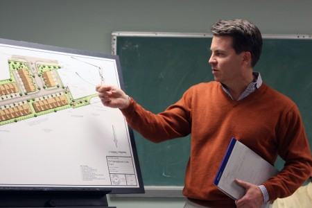 Attorney Den Webb gives a presentation to the Dunwoody Homeowners Association on Dec. 7 about a 40-unit townhouse development project proposed by Providence Group for Old Spring House Lane.