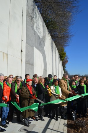 "Scores of business and government leaders, including Buckhead Coalition president Sam Massell, in red cap and scarf, braved the chill Jan. 9 to join the official ribbon cutting Jan. 9 for PATH400. A half-mile-long segment of the path that begins alongside the ""Buckhead wall"" on the Buckhead Loop opened Friday, Jan. 9."