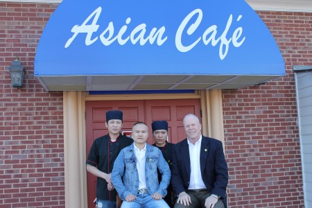 Front from left, Wenhe Zhang and Dunwoody Mayor Mike Davis. Back, from left, Yanzhong Wu and Danny Chen celebrate the restaurant's opening.