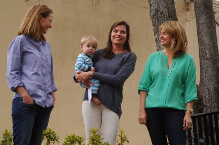 Left to right, Kim Nagy, Erin Mayo, holding son Colin, and Jennifer Srouji chat outside Morris Brandon Elementary.