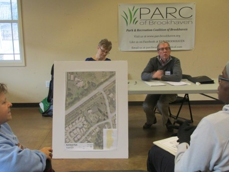 """Sue Binkert, left, and Jim Dupree, members of PARC Brookhaven, gather public input for the smaller city parks at a previous """"visioning  session."""" Parks discussed included Ashford, Georgian Hills and Skyland."""