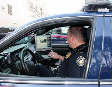 An Atlanta patrol officer uses PredPol, a computer program that uses past crime data to predict future crime, during his shift.