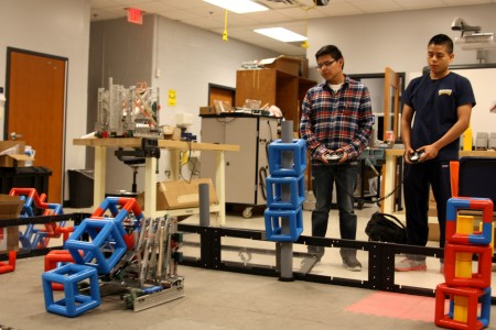Drivers Alex Agustin and Alejandro Tenorio show what Team 1264's VEX robot can do.