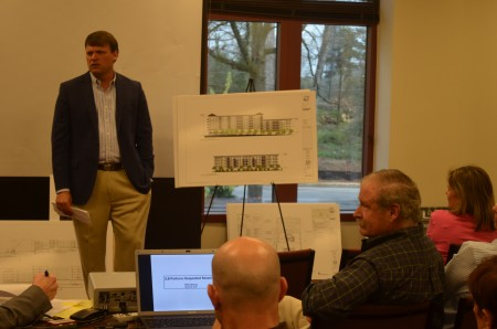 Hudson Hooks of JLB meets with homeowners to discuss the company's plans for a new development on Peachtree Road.