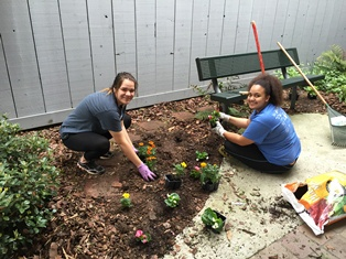 Casey Cunningham and Claudia Middleton of Chamblee High volunteer to help landscape.