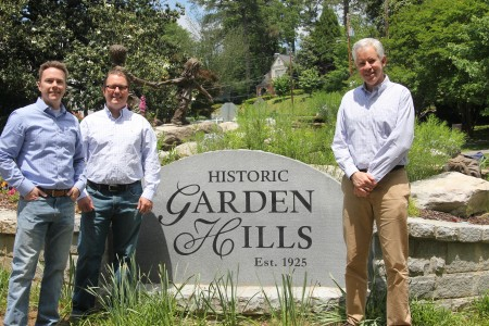From left, Bobby Wolf, Chris Sanders and Bob Schneider in front of one of the neighborhood's landscaped areas.