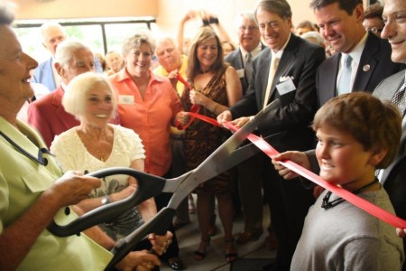 Left, then Mayor Eva Galambos cuts the ribbon at the opening of the Anne Frank exhibit in Sandy Springs in 2010. Galambos was instrumental in bringing the exhibit to the city from Decatur.