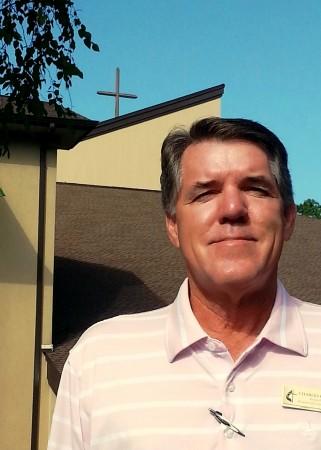 Pastor Charles Broome standing outside the Kingswood United Methodist Church in Dunwoody.