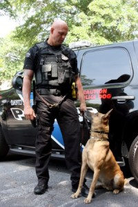 """Officer Mike DeWald, who earned statewide """"Officer of the Year"""" recognition from the American Legion and Rock, the dog DeWald says he owes it all to. Photo by Ellen Eldridge"""