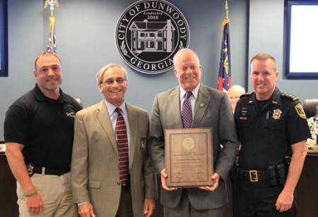 Pictured left to right: Sgt. Andrew Fondas, Frank Rotondo- Executive Director of GACP, Mayor Mike Davis, Chief Billy Grogan
