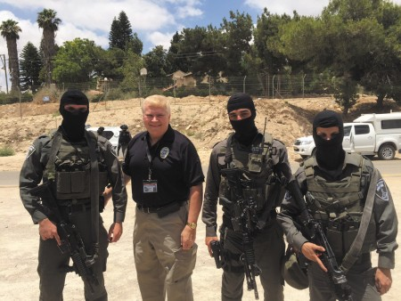 Brookhaven Police Chief Gary Yandura with Israeli border patrol guards during a recent presentation in Israel.