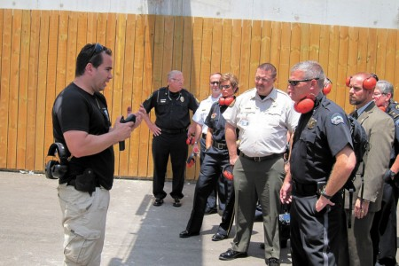 Sandy Springs Police Chief Ken DeSimone, right front, listens during an Israeli training session.