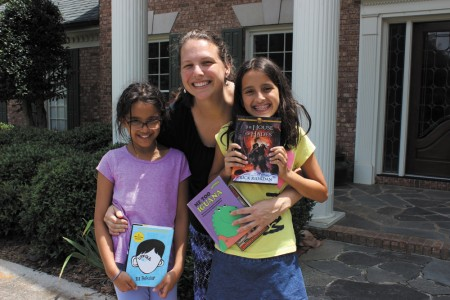 Kissy Dabbs, center, with daughters Liza Twari, 9, left, and Clara Twari, 10, generated the idea for the Mini Libraries by starting a neighborhood library in the basement of their Sandy Springs home.