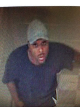 Atlanta police are seeking the man in the photograph after a teacher's purse was stolen from an elementary school