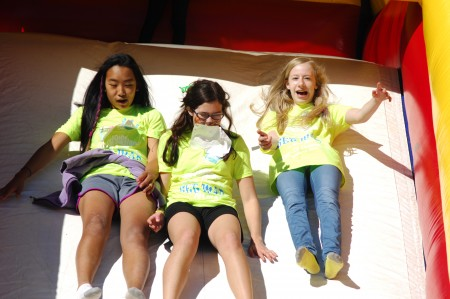 Peachtree Charter Middle School seventh graders Samantha Kasowski, Catherine Hanks and Julia Mann take a slide during the Dunwoody school's fall festival on Saturday, Oct. 17.