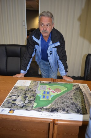 Sandy Springs resident Tom Ramseur looks over a drawing of The Galloway Schools proposed softball field and tennis courts on High Point Road.
