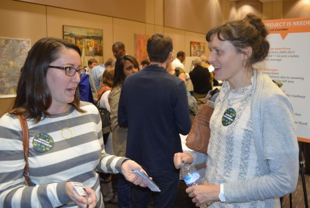 Katherine Jones, left, and Heather Luyk discuss planned changes on Peachtree Road during a Georgie Department of Transportation meeting at the Shepherd Center on Oct. 29.