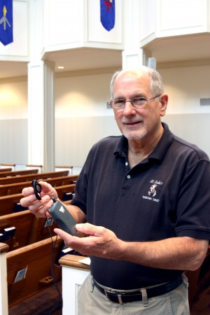 Roby Price, the facilities manager at Saint Luke's shows the current headsettechnology available for church guests. The hearing loop system to be installed this week will allow anyone with activated telecoils in their hearing aids to hear better. Handsets for the hearing loop system will be available for people without hearing aids.