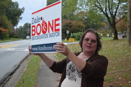 Anna Cannon encourages drivers on Ashford-Dunwoody Road to vote for Dale Boone for mayor of Brookhaven in the city election Nov. 3.