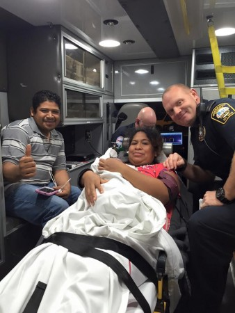 Left to right: Alejandro Bibiano, Rosa Bibiano, Mateo Alejandro Bibiano (in mother's arms) and Lt. Jeff Vanaman in the ambulance on the way to a hospital Nov. 16. Photo courtesy Brookhaven Police Department.
