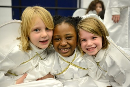 Pre-First students (left to right) Carys Allen, Keiden Brown and Audrey Jordan prepare to perform in their first Pace Academy holiday program.