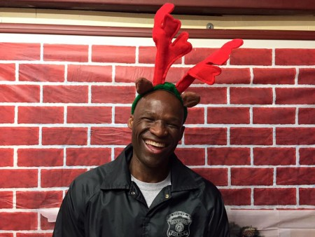 Prisoner Transport Officer Brian Bolden volunteers at the Dec. 19 Christmas for Kids program. Photo courtesy Dunwoody Police Department.