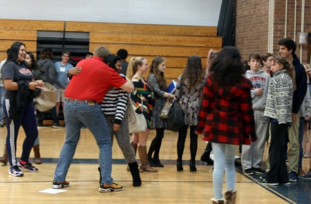 Councilman John Heneghan hands out hugs at Dunwoody High School during a Dec. 3 Town Hall.