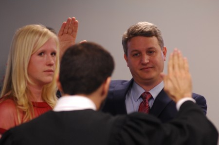 John Ernst is sworn in to office as Brookhaven's new mayor on Jan. 4. His wife, Monica Ernst, held a family bible as DeKalb Judge Mike Jacobs delivers the oath.