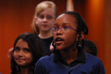 Fifth grader Sasha Graham sings a solo backed by other members of the Spalding Drive Charter Elementary show choir, including Valentina Cruz, at left, Katie Johnson, at rear.