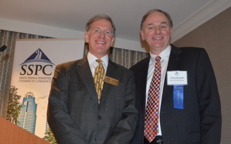 Lever Stewart, left, takes over as chairman of the Sandy Springs/Perimeter Chamber of Commerce from Chris Burnett, right, during the chamber's annual luncheon on Jan. 21.
