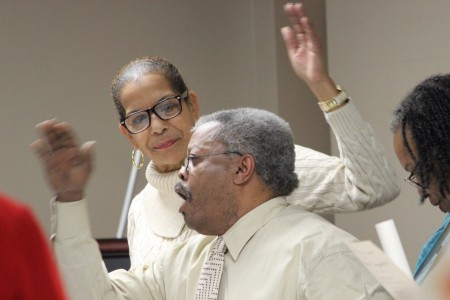 Janice Anderson, left, and Eldredge Jackson, also L ynwood Integrators, sing the Lynwood Park High School Class song.