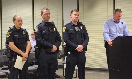Dunwoody Police Chief Billy Grogan, far right, introduces the newest officers to the Dunwoody Police department at the Jan. 25 City Council meeting. From left are Guinevere Wiencek, Michael Vermillion and Justin Hensal. Mayor Denny Shortal swore them in.