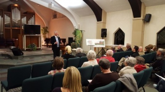 Roy Dickson, president and CEO of Parc Communities, speaks to residents at the Jan. 25 meeting at Apostles Church. (Photo John Ruch)