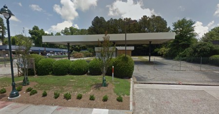A Google Earth image of the shuttered gas station at 8475 Roswell Road as it looked in June 2015.
