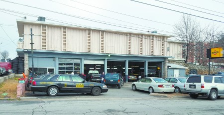 The former Eddie's Automotive, now Magic Mike's, at 260 Mount Vernon Highway, is considered historic by the state Historic Preservation Division. (Photo John Ruch)