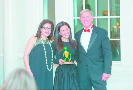 Cara Workman, left. and Robyn Marzullo of the Sandy Springs Gun Club & Range received the 2016 Small Business of the Year award from Sandy Springs/Perimeter Chamber of Commerce Board Chair Lever Stewart.