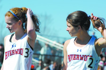 Riverwood International Charter High School students Elizabeth Graves, left, and Anna Hayden prepare before the second heat of the 1-mile race.