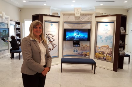 Deb MacKay, the Church of Scientology of Georgia's community affairs director, stands in the new church's Public Information Center. (Photo John Ruch)