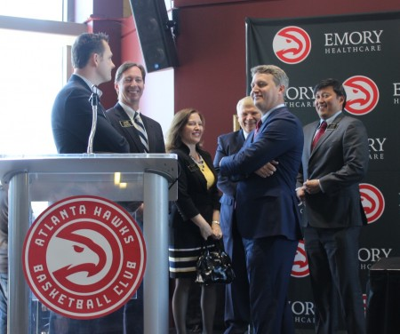 From left, state Rep. Taylor Bennett; City Council members Bates Mattison and Linley Jones; City Manager Gary Yandura; Mayor John Ernst; and council member John Park celebrate the Hawks' plan to open a training facility during a press conference at Philips Arena on April 5. (Photo Dyana Bagby)