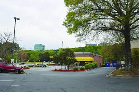 A view from Powers Ferry Road showing Powers Ferry Landing's mix of street-level businesses, wooded areas and highrise office towers. (Photo John Ruch)