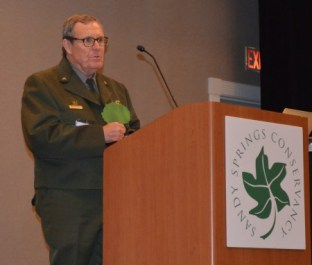 Park Ranger Jerry Hightower of the Chattahoochee River National Recreation Area holds the tree-shaped Greenspace Champion Award he received at the April 13 Sandy Springs Conservancy dinner. (Photo John Ruch)